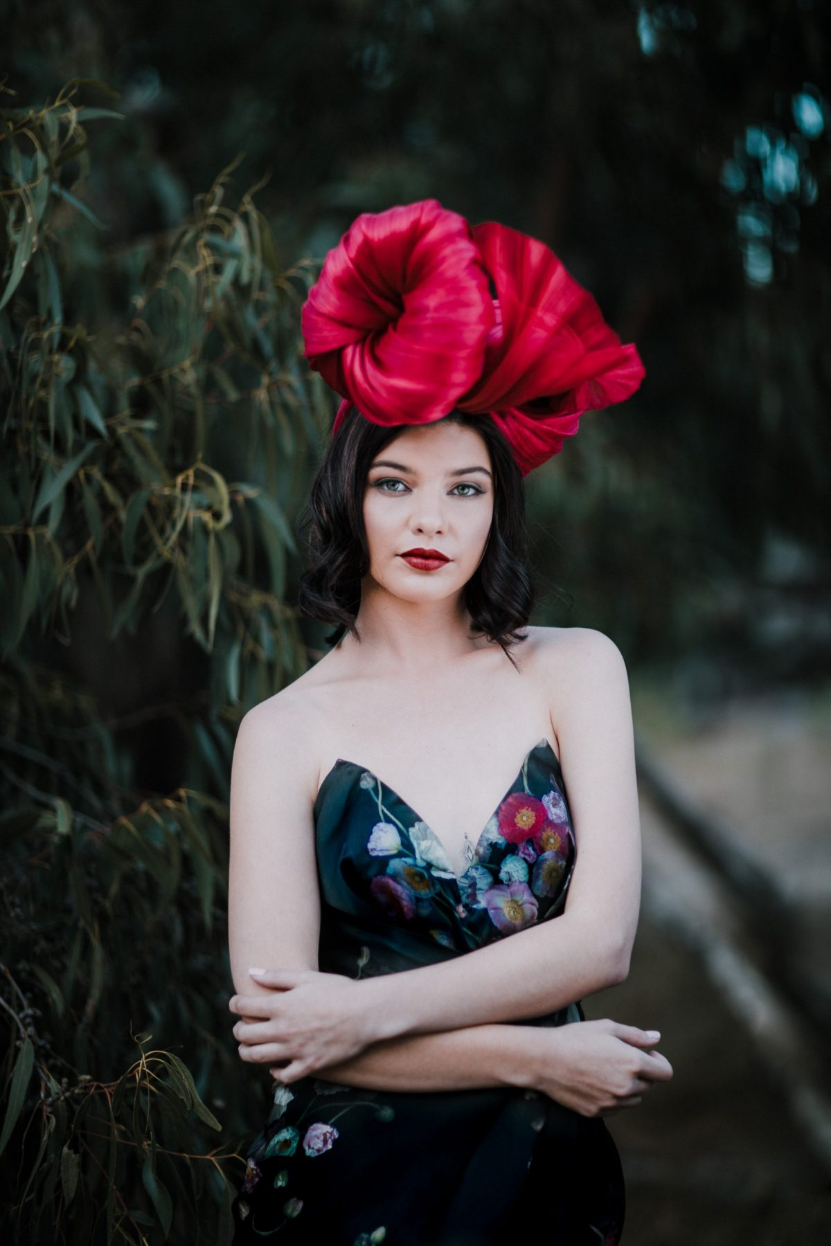 Red Millinery on model - millinery fashion photos