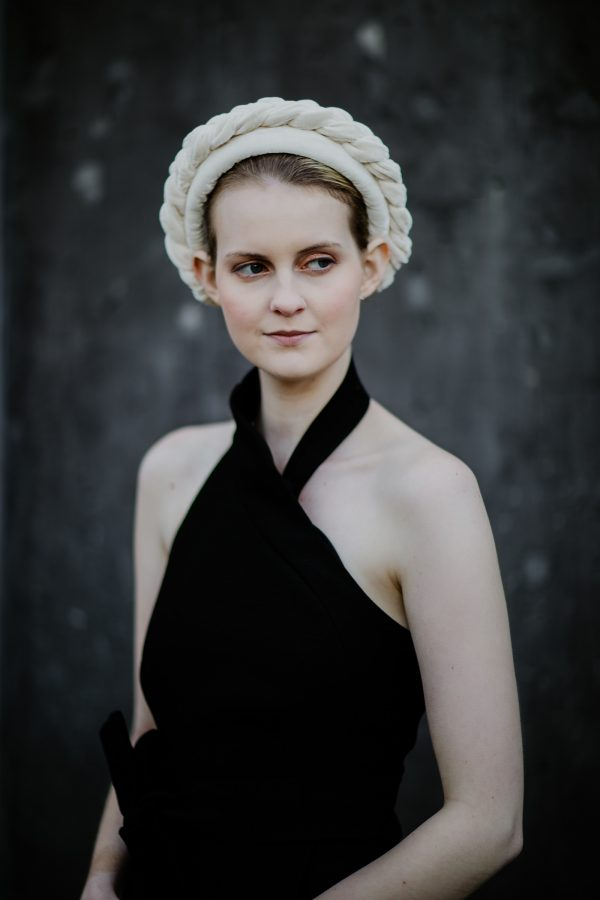 cream headband on model with black dress - derby day outfit - stylish and royal