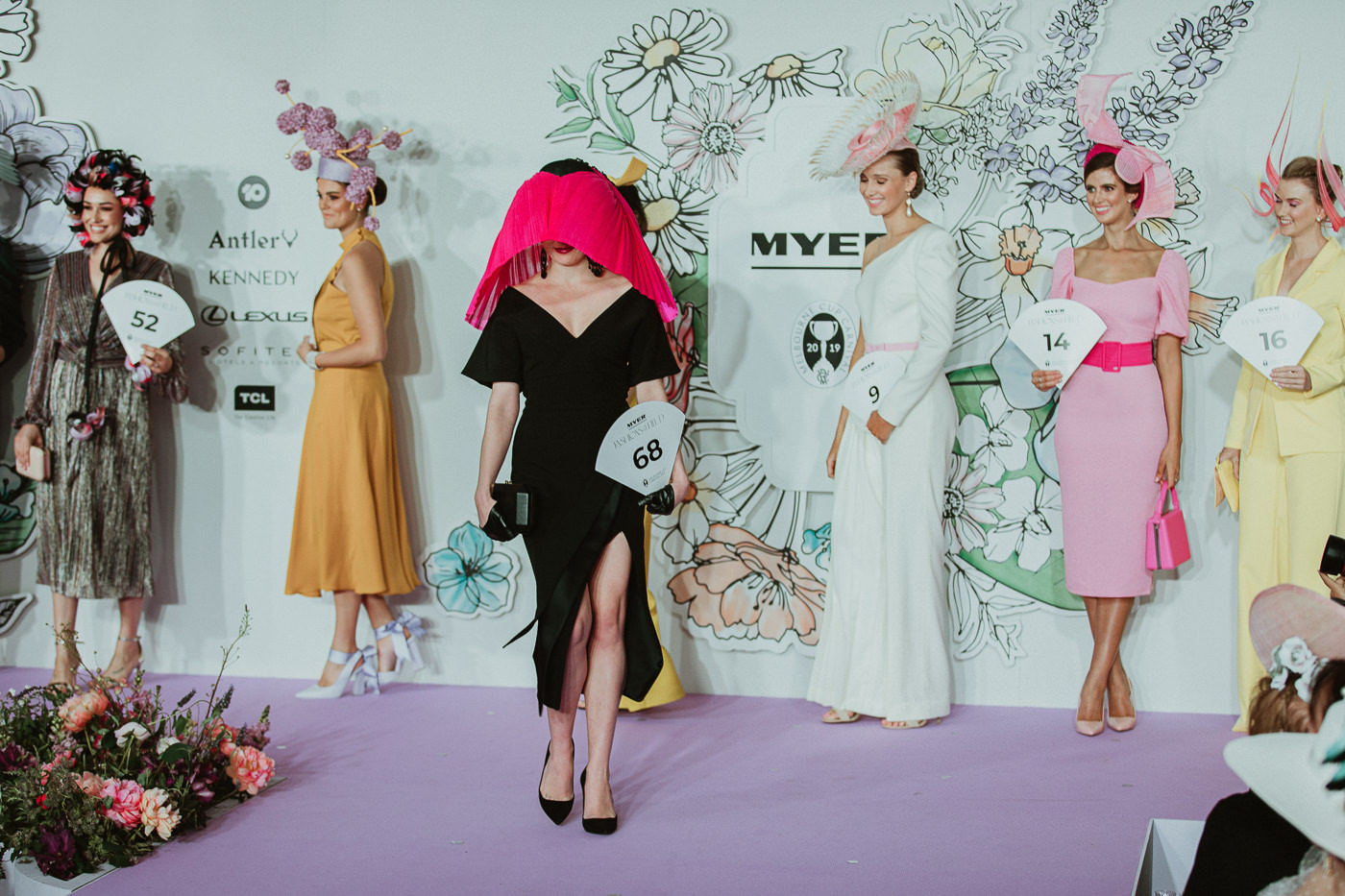 award winning millinery - model on stage - runway fashion and millinery